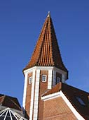 A Red Spire Atop a Red Brick Danish Building