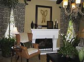 Living Room with Fireplace and Gold Wing-Back Chair